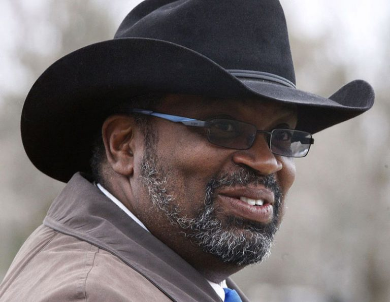 African American male wearing a black cowboy hat and glasses.
