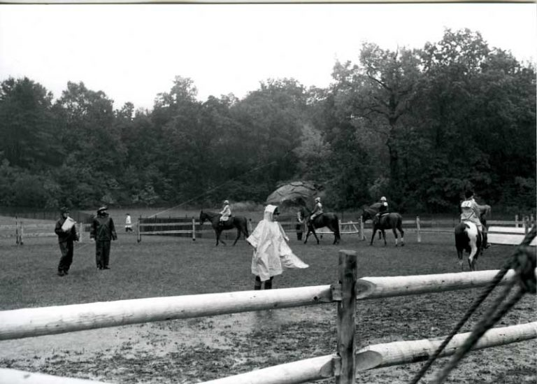 Old black and white picture of horse rider.